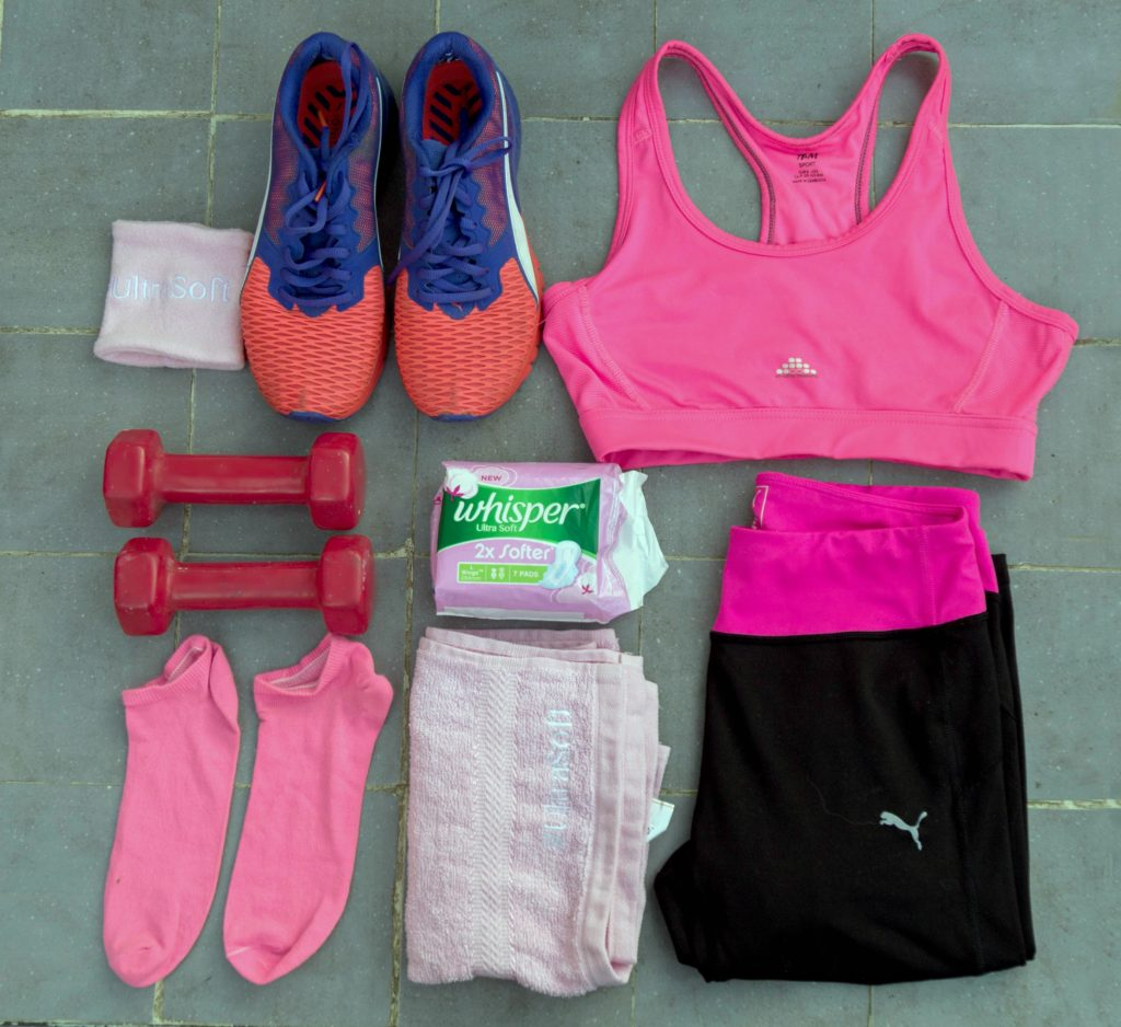 New Whisper Ultra Soft,sanitary napkins, gym flat lay
